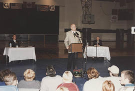 Deane Downey speaking during a debate between Svend Robinson and Paul Chamberlain