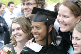 A group of smiling students at Graduation 2005