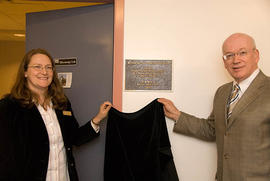 Eve Stringham with Jonathan Raymond, unveiling a plaque