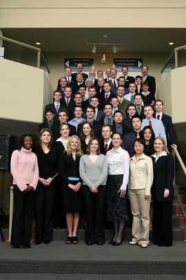 2004 graduating class of Business students with their professors