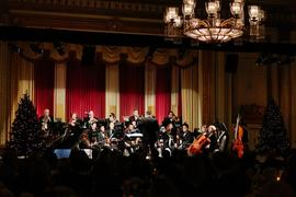 Calvin Dyck conducting an orchestra during the Christmas in the City gala