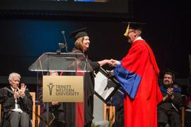 Faculty member Heather Meyerhoff accepting an award