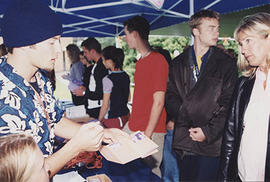Parents and students lining up in a tent during O-Week