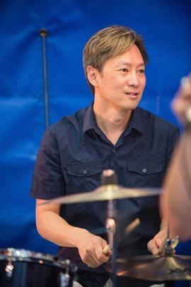 Kim Chen playing the drums on Community Day