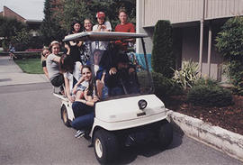 Student leaders piled into a golf cart during O-Week