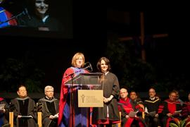 Sheryl Reimer-Kirkham introducing a student during the School of Graduate Studies (SGS) commencement