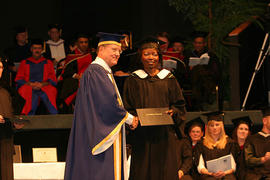 President Snider with an unidentified graduating student