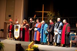 Sara Pearson leading prayer during SGS Graduation
