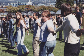 Rows of students holding hands during O-Week games