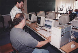 IT staff working on computers in a lab or classroom during O-Week