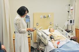 Nursing instructor demonstrating new equipment in the Nursing Sim Lab