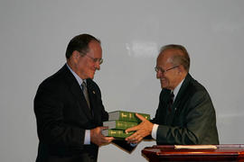 Albert Pietersma presenting Neil Snider with a set of books, at the inauguration of the Septuagint Institute
