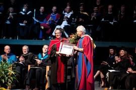 Claudia Launhardt receiving the Provost's Innovative Teaching Award from Bob Burkinshaw
