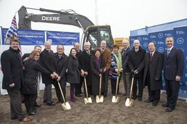 Administrators, supporters, and dignitaries posing with shovels during the Richmond campus ground...