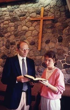 Kim Sawatsky and Arvid Olson reading the Bible together in Chapel