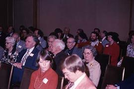 View of an audience attending an unidentifed event.