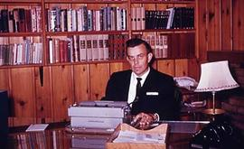 President Calvin Hanson sits in his office.