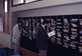 Individuals looking through material in the journal and magazine area in the Vernon Strombeck Lib...