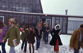 Slide 44 - students leaving the Chapel on a snowy day
