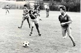 Cheryl Folk pursuing a soccer ball in a game