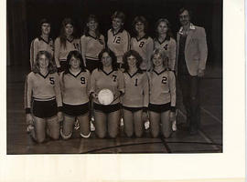 Women's volleyball team posing for a team picture