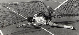 Student tangled in tennis net