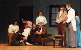 "Students, in costume, performing ""A Christmas Carol"""