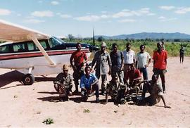 "A typical crowd of adult ""welcomers"" on a Mozambique airstrip"