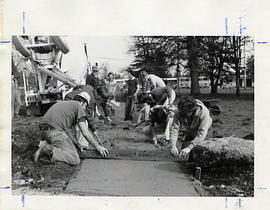 Students leveling cement during the Work-a-thon