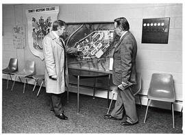 Robert Thompson and Austen Torrell loking at a campus plan