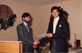 Dave Thomas presenting an award to Ian Uhryn
