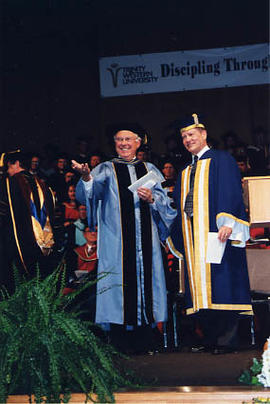 Dr. Snider and guest at graduation ceremonies