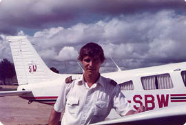 Alumnus Marty Overduin posing with an aircraft