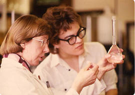 Faculty member helping a student in the lab