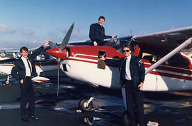 Three students preparing a plane at the Langley Airport
