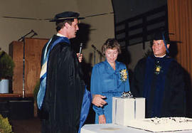 Dr. and Mrs. Snider being presented with a gift