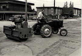 Maintenance worker on a tractor