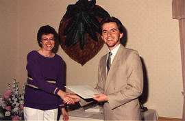 Jeanette Blaker presenting an award to an unidentified student