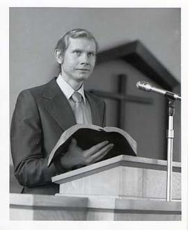 Staff member speaking from a pulpit