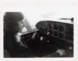 An Aviation student flying an airplane