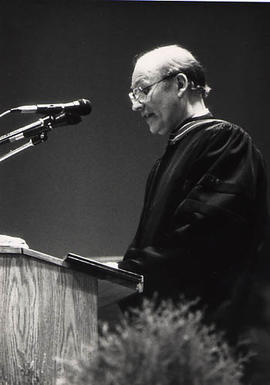 Speaker at the podium during the graduation ceremony