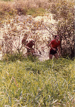 Students emerging from The Pond during The Challenge