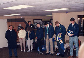 Basketball team praying before going to Guatemala