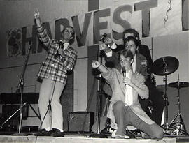 Students singing on stage during the Harvest Fest