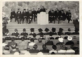 Administration addressing graduates in the chapel