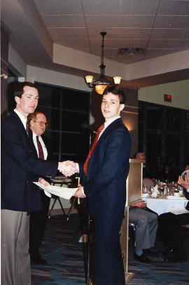 Todd Robinson receiving an award