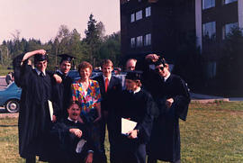 Graduates and staff pose together