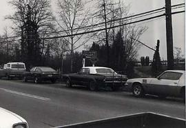 Cars parked along Glover Road.