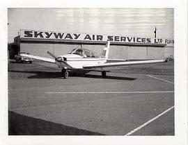 An airplane idling in front of Skyway Air Services Ltd. Building