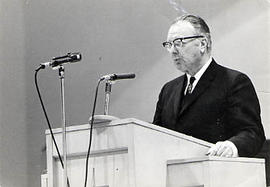 Dr. Arnold T. Olson preaching